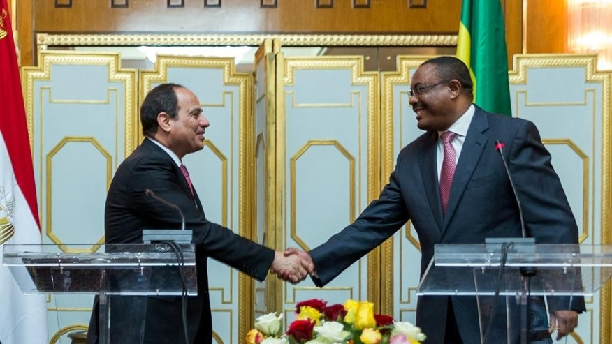 Egyptian president Fattah al-Sisi, left, and Ethiopian prime minister Hilemariam Desalegn, right, shake hands after the press conference at The National Palace Tuesday,  March 24, 2015 in Addis Ababa Ethiopia. The leaders of Egypt and Ethiopia have agreed to upgrade talks over the controversial Grand Ethiopian Renaissance Dam that Addis Ababa is constructing over the Nile River. (AP Photo/ Mulugeata Ayene)