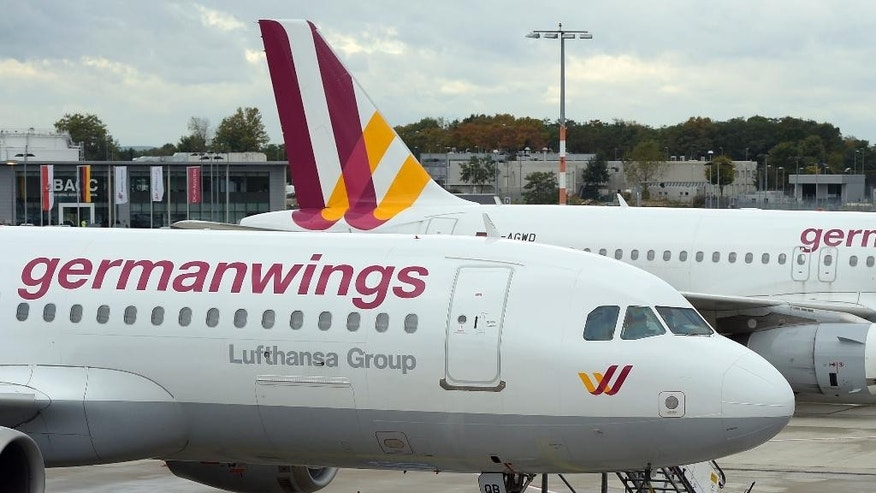 FILE - In this Oct. 16, 2014  an Airbus A 320 of the German airline Germanwings is parked at the airport in Cologne, Germany, as their pilots went on strike. French President Francois Hollande said no survivors are likely in the Alpine crash of a passenger jet carrying 148 people.  The Germanwings passenger jet crashed Tuesday, March 24, 2015 in the French Alps region as it traveled from Barcelona to Duesseldorf, French officials.   (AP Photo/Martin Meissner)