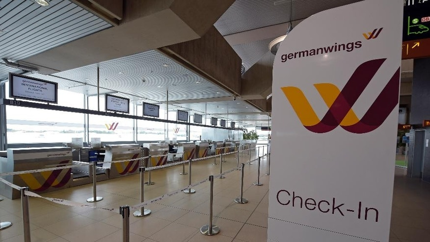 FILE - The Oct. 16, 2014 file photo shows counters of German airline Germanwings at the airport in Cologne, Germany.  An Airbus plane of Germanwings with at least 142 passengers, two pilots and four flight attendants on board has crashed in the Alps region Tuesday, March 24, 2015. (AP Photo/Martin Meissner, file)