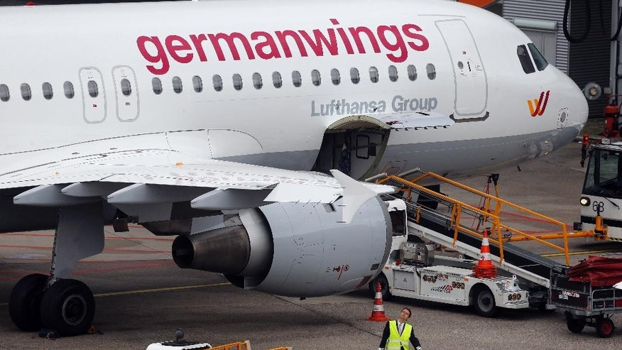 FILE - In this Oct. 16, 2014 file photo an Airbus 320 of Germanwings is parked at the airport as their pilots went on strike in Duesseldorf, Germany.  A Germanwings Airbus plane with at least 142 passengers, two pilots and four flight attendants on board has crashed in the Alps region Tuesday, March 24, 2015.  (AP Photo/Frank Augstein)
