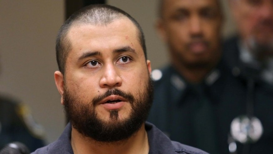 SANFORD, FL - NOVEMBER 19:  George Zimmerman the acquitted shooter in the death of Trayvon Martin, answers questions from a Seminole circuit judge during a first-appearance hearing on charges including aggravated assault stemming from a fight with his girlfriend November 19, 2013 in Sanford, Florida. Zimmerman, 30, was arrested after police responded to a domestic disturbance call at a house. He was acquitted in July of all charges in the shooting death of unarmed, black teenager, Trayvon Martin.   (Photo by Joe Burbank-Pool/Getty Images)