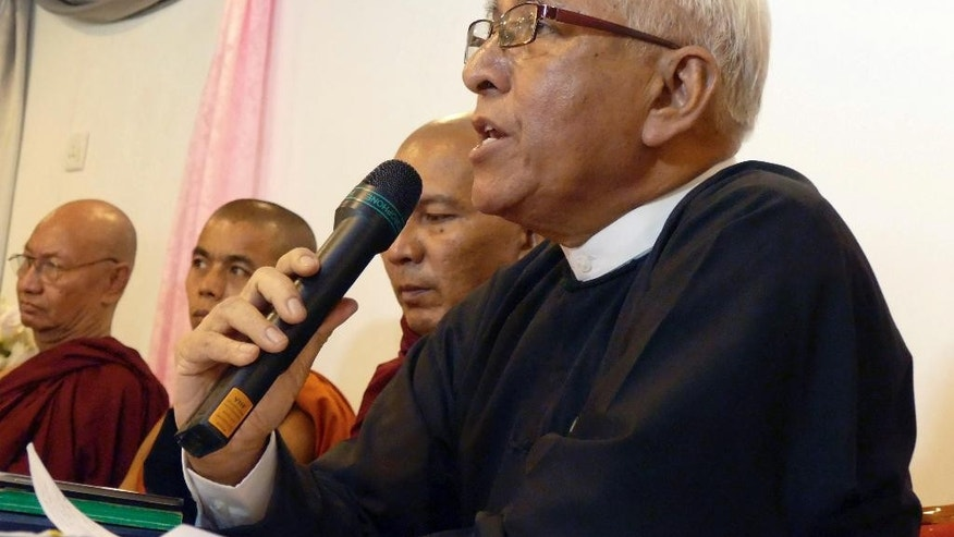 FILE - In this March 16, 2015 file photo, lawyer Aung Thein speaks during a press conference in Yangon, Myanmar. Police in northwestern Myanmar have rejected a lawsuit filed by two Buddhist monks against Myanmar's home minister and police chief, saying they are protected by law. In declining to accept a first information report, which is needed for a lawsuit to proceed, the police said no lawsuit can be brought against any officer who carries out acts in good faith. Human rights lawyer Aung Thein said Tuesday, March 24, 2015 that the two Buddhist monks, among scores seriously burned during a 2012 police crackdown on protests at a Chinese-backed copper mine, registered the first information report at the Hsalingyi police station. (AP Photo/Khin Maung Win, File)