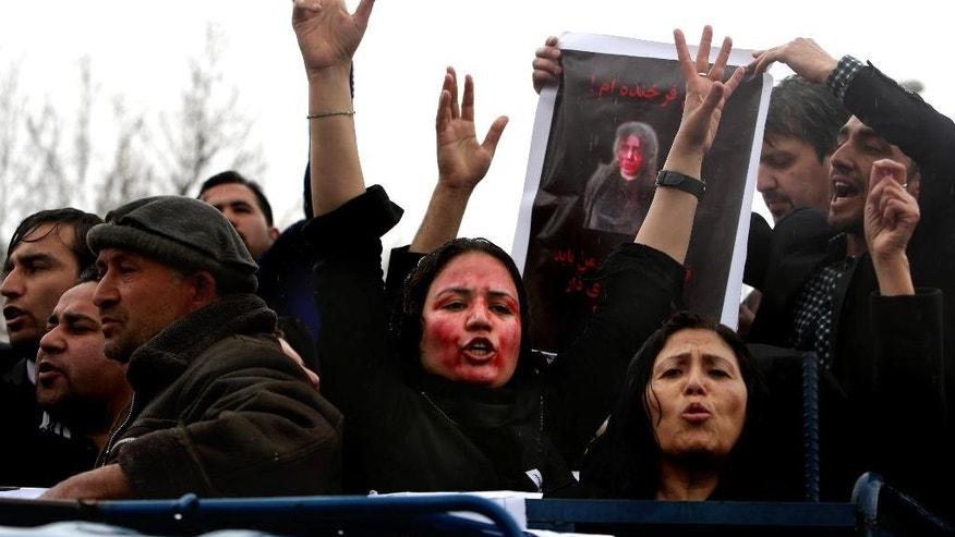 Afghan women chant slogans during a protest demanding justice for a woman who was beaten to death by a mob after being falsely accused of burning a Quran last week, in downtown of Kabul, Afghanistan, Tuesday, March 24, 2015. Men and women of all ages carried banners bearing the bloodied face of Farkhunda, a 27-year-old religious scholar killed last week by a mob. Farkhunda, who went by one name like many Afghans, was beaten, run over with a car and burned before her body was thrown into the Kabul River. (AP Photo/Rahmat Gul)