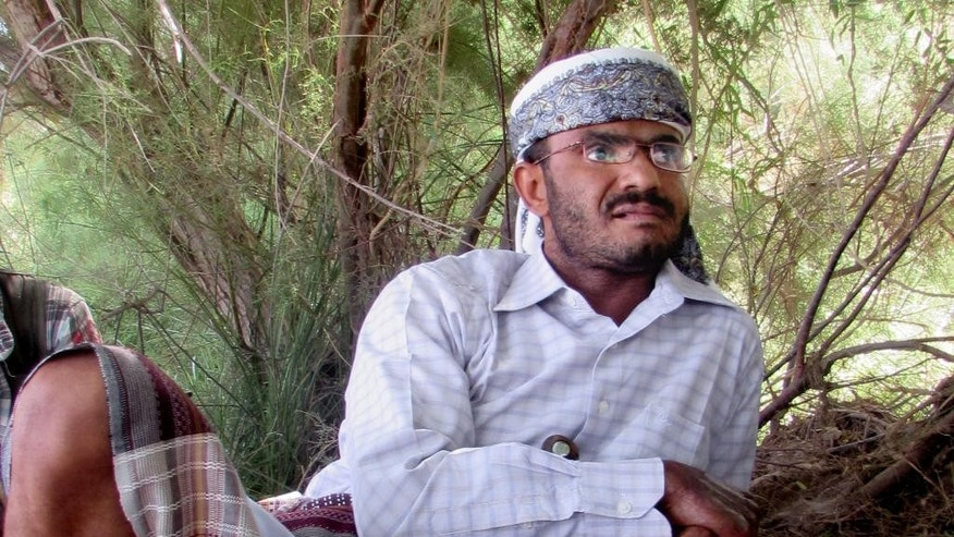 "In this Tuesday, March 17, 2015 photo, Abdul-Lateef al-Sayed al-Bafqeeh, leader and founder of the government-backed militia formally known as the ""Popular Committees,""listens to a reporter during an interview with The Associated Press in southern Abyan province, Yemen. Al-Bafqeeh and his militiamen joined the military in its campaign to expel al-Qaida from Abyan, ending a 14-month occupation by the terror group in 2012.  Now he and his men will be the ones thrown into the thick of battle in Yemen's seemingly imminent civil war, fighting alongside fellow southern Yemenis loyal to embattled president Abed Rabbo Mansour Hadi against northern forces loyal to the nation's ousted leader and his Iranian-backed Shiite rebel allies.  (AP Photo/Yassir Hassan)"