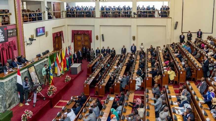 "Egyptian President Abdel-Fattah el-Sissi, middle, on the far left table seated, addresses the Ethiopian parliament Wednesday, March 25, 2015,  in Addis Ababa Ethiopia. — The leaders of Ethiopia and Egypt said on Tuesday that they are hopeful talks over sharing Nile River waters will end in agreement. Egyptian President Abdel-Fattah el-Sissi told reporters in the Ethiopian capital of Addis Ababa, where he is on an official visit, that Ethiopia and Egypt are ""on the right path to cooperation"" following the signing of an initial agreement between Sudan, Egypt and Ethiopia. (AP Photo/ Mulugeta Ayene)"