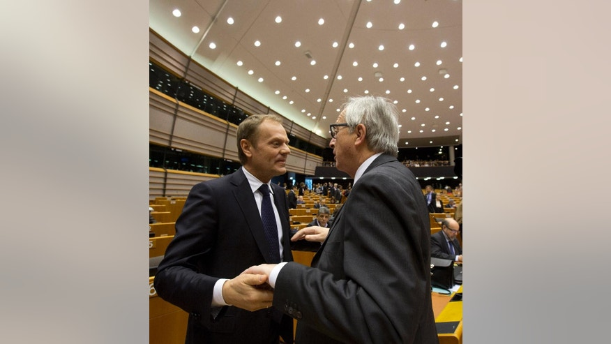 European Commission President Jean-Claude Juncker, right, speaks with European Council President Donald Tusk during a plenary session at the European Parliament on Wednesday, March 25, 2015. The Energy Union, relations with Russia and the situation in Ukraine are up for a debate with the Commission and the Council on the conclusions of the March European Council. (AP Photo/Virginia Mayo)