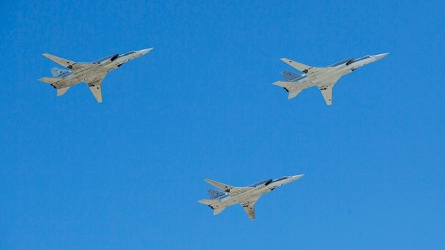 FILE - In this Friday, May 9, 2014 file photo Russian bombers Tu-22M3 fly in formation during a Victory Day Parade in Moscow commemorating the 1945 defeat of Nazi Germany. (AP Photo/Pavel Golovkin, File)