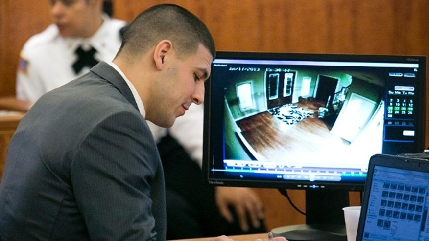 Hernandez takes notes during his murder trial in Fall River, Mass., on Wednesday, March 25, 2015.