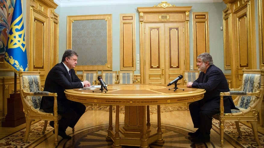 March 25, 2015: Ukraine's President Petro Poroshenko, left, listens to Ihor Kolomoysky, governor of Dnipropetrovsk, in Kiev, Ukraine.