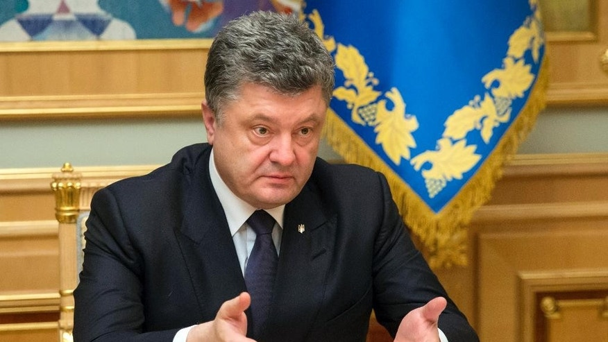Ukraine's President Petro Poroshenko gestures while speaking to Ihor Kolomoysky, governor of Dnipropetrovsk, in Kiev, Ukraine, Wednesday, March 25, 2015. Poroshenko has fired the billionaire governor of an eastern region following a rancorous dispute pitting the tycoon against the government. (AP Photo/Mikhail Palinchak, Presidential Press Service)