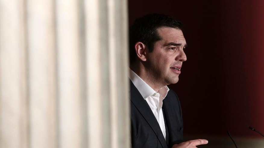 Greece's prime minister Alexis Tsipras delivers a speech at Athens University, Wednesday March 25, 2015. Tsipras' speech took place during a special gathering to commemorate Greece's Independence Day, which marks the start of the uprising against the Ottomans back in 1821. (AP Photo/Panayiotis Tzamaros)