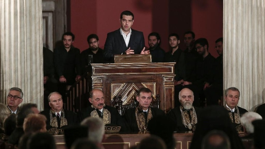 Greece's prime minister Alexis Tsipras delivers a speech inside Athens University, Wednesday March 25, 2015. Tsipras' speech took place during a special gathering to commemorate Greece's Independence Day, which marks the start of the uprising against the Ottomans back in 1821. (AP Photo/Panayiotis Tzamaros)
