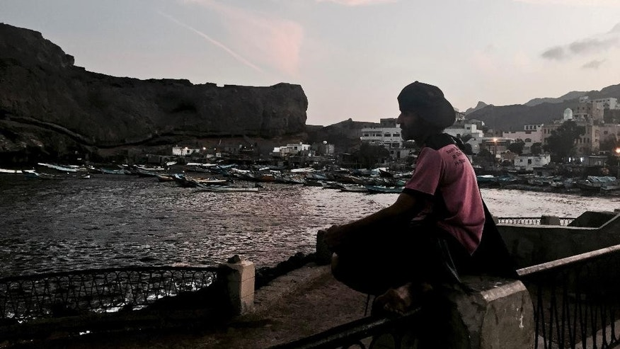 In this Saturday, March 21, 2015 photo, a man spends time by himself at the fishing harbor of the Arabian Sea in Aden, Yemen. Calls among southern Yemenis to break away once more are accelerating as the country collapses into conflict. Shiite rebels known as Houthis have taken over the capital, Sanaa, and much of the north, and are storming south in a bid to secure their hold on the country. (AP Photo/Hamza Hendawi)