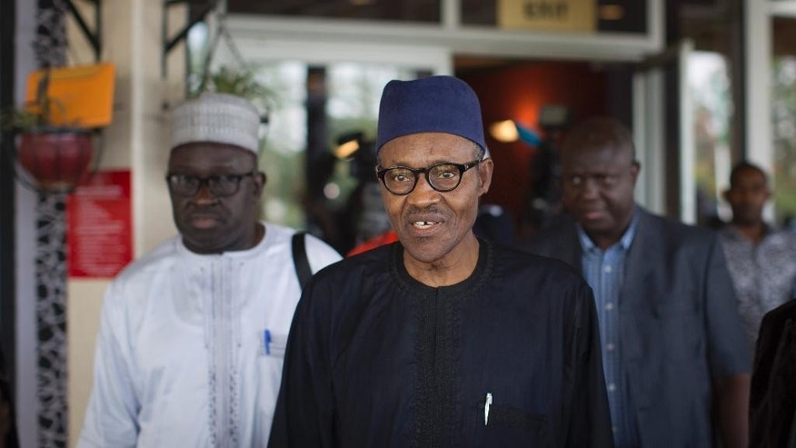 "Nigerian opposition candidate Gen. Muhammadu Buhari walks to his vehicle after signing a joint renewal with President Goodluck Jonathan of their pledge to hold peaceful ""free, fair, and credible"" elections, at a hotel in the capital Abuja, Nigeria Thursday, March 26, 2015. Nigerians are due to go to the polls to vote in presidential elections on Saturday. (AP Photo/Ben Curtis)"