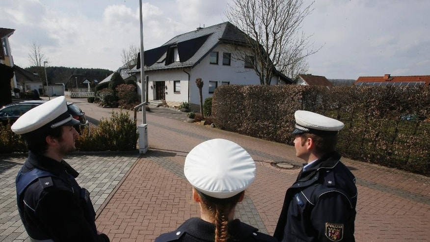 Police hold media away from the house where Andreas Lubitz lived in Montabaur, Germany, Thursday, March 26, 2015. Lubitz was the copilot on flight Germanwings 9525 that crashed with 150 people on board on Tuesday in the French Alps. (AP Photo/Michael Probst)
