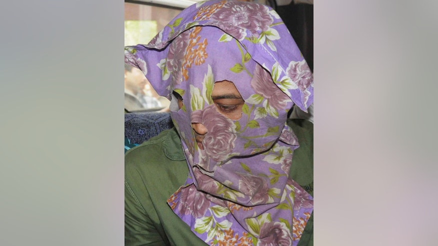 Mohammad Salim, one of the two suspects arrested by police in the gang rape of an elderly nun in in a missionary school in eastern India nearly two weeks ago, is brought to be produced before the Ranaghat Court in Nadia, West Bengal state, Thursday, March 26, 2015. A police officer says the suspects were arrested Thursday after a nationwide hunt. The nun, in her 70s, was hospitalized in serious condition. (AP Photo/Press Trust of India) INDIA OUT