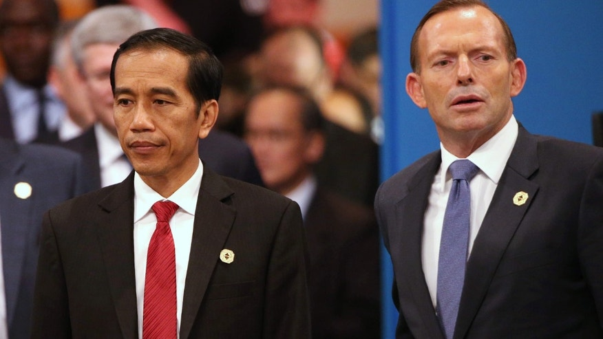 Nov. 15, 2014: Indonesian President Joko Widodo, left, and Australian Prime Minister Tony Abbott walk into a meeting room for a plenary session at the G-20 summit in Brisbane, Australia.