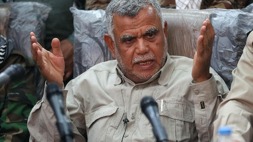 Iraqi militia leader Hadi al-Amiri speaks to the press in Samarra, Iraq 95 kilometers (60 miles) north of Baghdad, Iraq, Wednesday, March 25, 2015. Al-Amiri insisted that the Popular Mobilization Unit, which consists of various militias, does not need assistance from coalition forces to retake the militant-held city of Tikrit.  The U.S. and Iraq have been discussing possible U.S. airstrikes in support of a stalled Iraqi ground offensive against a dug-in Islamic State force in Tikrit, U.S. officials said Wednesday. The prospect of U.S. airstrikes in Tikrit raises highly sensitive questions about participating in an Iraqi campaign that has been spearheaded by Iraqi Shiite militias trained and equipped by Iran, an avowed U.S. adversary. (AP Photo/Karim Kadim)