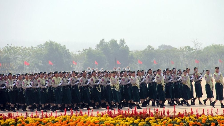 "Myanmar female military soldiers march as they leave the venue during a ceremony to mark the 70th anniversary Armed Forces Day, in Naypyitaw, Myanmar, Friday, March 27, 2015. Myanmar's powerful military commander pledged Friday to work to support successful elections in November, calling it ""an important landmark for democracy implementation,"" and warned that the army will not tolerate instability or armed threats. (AP Photo/Khin Maung Win)"