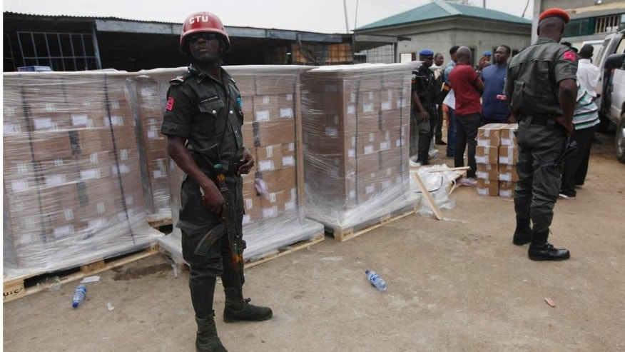 Nigerian police officers guards presidential election ballot papers and other electoral material at the election commission office in Yaba, neighborhood  in Lagos, Nigeria, Thursday, March. 26, 2015. Nigeria goes to the polls Saturday to elect a new President. (AP Photo/Sunday Alamba)