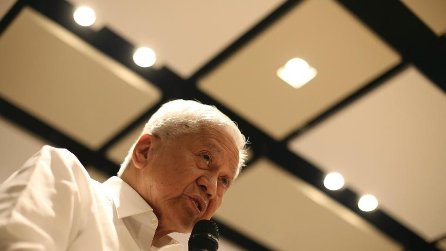Philippine Foreign Secretary Albert del Rosario speaks during a news forum in suburban Pasig, east of Manila, Philippines Thursday, March 26, 2015. Rosario said China has been rushing construction projects, including massive land reclamations in the disputed South China Sea, before it gets potentially restricted by a proposed nonaggression pact and a case questioning the legality of Beijing's territorial claims. (AP Photo/Aaron Favila)