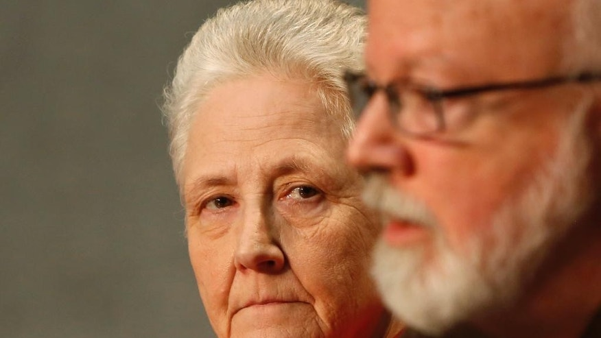 FILE - In this May 3, 2014 file photo, Cardinal Sean O'Malley, the archbishop of Boston, right, and Marie Collins attend a press conference at the Vatican. Several members of Pope Francis' sex abuse advisory board are expressing concern and incredulity over his decision to appoint the Chilean bishop to a diocese despite allegations that he covered up for Chile's most notorious pedophile. In interviews and emails with The Associated Press, the experts have questioned Francis' pledge to hold bishops accountable and keep children safe, given the record of Bishop Juan Barros in the case of the Rev. Fernando Karadima. The five commission members spoke to the AP in their personal and professional capacity and stressed that they were not speaking on behalf of the commission, which Francis formed in late 2013 and named Boston Cardinal Sean O'Malley to head. Commission member, Marie Collins, herself a survivor of abuse, said she couldn't understand how Francis could have appointed Barros given the concerns about his behavior. (AP Photo/Riccardo De Luca)