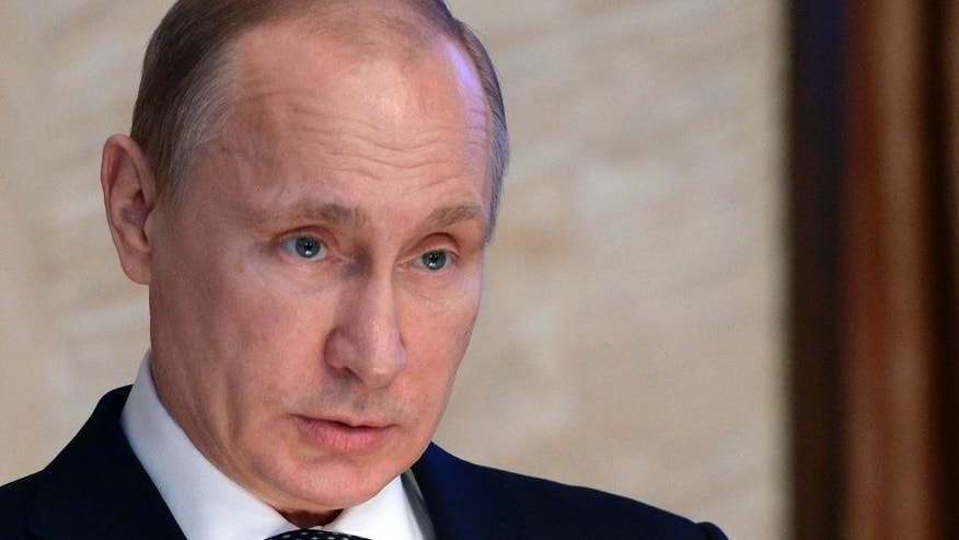 Russian President Vladimir Putin speaks before officials of the Federal Security Service in Moscow, Russia, Thursday, March 26, 2015. (AP Photo/RIA-Novosti, Alexei Nikolsky, Presidential Press Service)