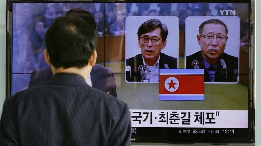 "A South Korean man watches a TV screen reporting about South Korean Kim Kuk Gi, left, and Choe Chun Gil detained in North Korea, at the Seoul Railway Station in Seoul, South Korea, Friday, March 27, 2015. South Korea urged North Korea to immediately release two of its citizens detained in the country over alleged espionage charges, the latest in a series of arrests in the North of foreign nationals. The letters read ""Detained Kim Kuk Gi, Choe Chun Gil.""  (AP Photo/Ahn Young-joon)"