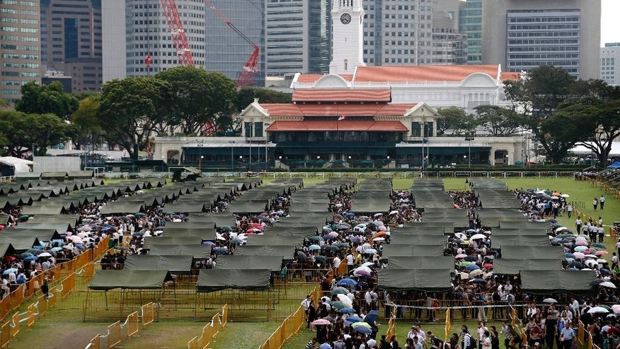 Tents are set up to provide shade for members of the public, as they stand in line to pay their respects for the late Lee Kuan Yew at the Parliament House where he will lie in state for four days, Thursday, March 26, 2015, in Singapore. Lee, 91, died Monday at Singapore General Hospital after more than a month of battling severe pneumonia. The government declared a week of mourning for the leader who is credited with transforming the resource-poor island into a wealthy finance and trade hub with low crime and corruption in a region saddled with graft, instability and poverty. (AP Photo/Wong Maye-E)
