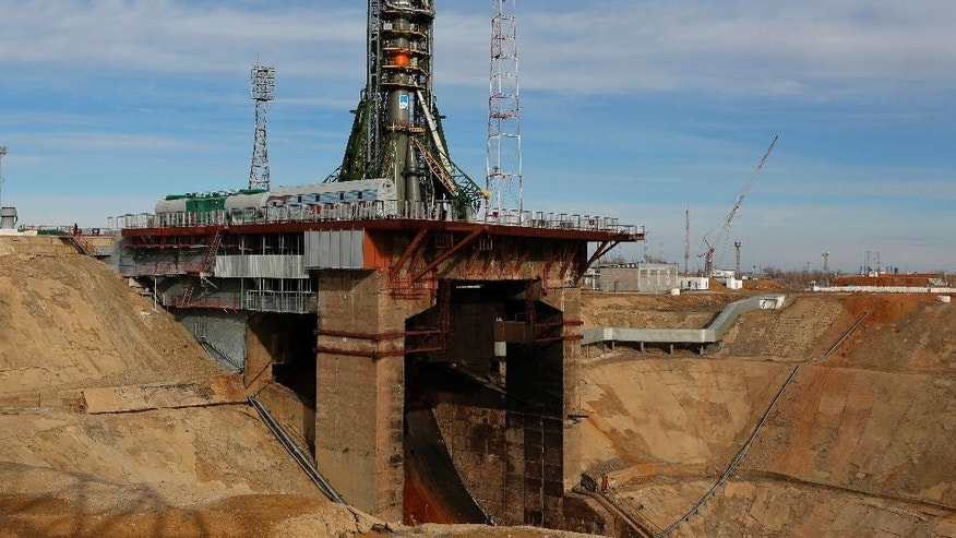 Russia's Soyuz-FG booster rocket with the space capsule Soyuz TMA-16M that will carry a new crew to the International Space Station (ISS) is installed at the launch pad in Russian leased Baikonur cosmodrome, Kazakhstan, Friday, March 27, 2015. The new Soyuz mission is scheduled for Saturday, March 28.(AP Photo/Dmitry Lovetsky)