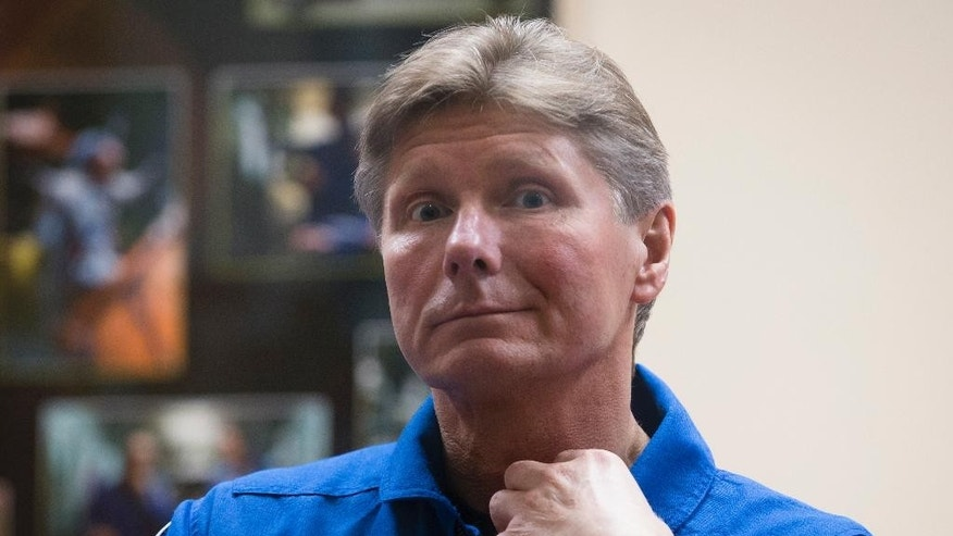 Russian cosmonaut Gennady Padalka, crew member of the mission to the International Space Station, ISS, attends a news conference in Russian leased Baikonur cosmodrome, Kazakhstan, Thursday, March 26, 2015. The start of the new Soyuz mission is scheduled on Saturday, March 28. (AP Photo/Dmitry Lovetsky)