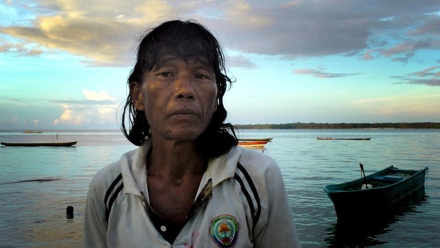 "This Friday, Nov. 28, 2014 image shows Ngwe Thein, 42, who has been living on an island near Benjina, Indonesia for three years, after being forced to work on a fishing trawler with inadequate food and little or no pay, he said. In the wake of an AP report on  fishermen who were enslaved, on Thursday, March 26, 2015, Thai lawmakers voted unanimously to create tougher penalties for violating the country's anti-human trafficking law, including the death penalty. But in a Thursday email, Phil Robertson, deputy director of Human Rights Watch's Asia division said, ""The Thailand government has made repeated verbal commitments to get tough with traffickers but every time real follow-up has been lacking."" In the meantime, Thein is one of the thousands of men who are waiting. (AP Photo/APTN, Esther Htusan)"