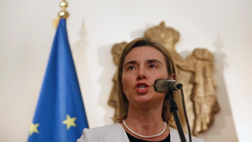 EU High Representative for Foreign Affairs and Security Policy Federica Mogherini, speaks during a press conference with Serbian Prime Minister Aleksandar Vucic, during her first visit in Belgrade, Serbia, Friday, March 27, 2015. (AP Photo/Darko Vojinovic)