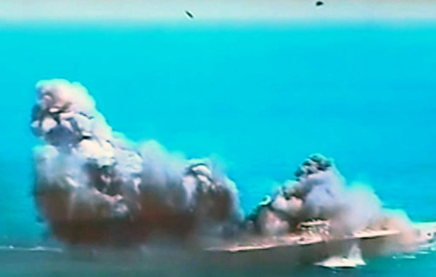 """This image taken from Iranian state TV, shows damage to a mock U.S. aircraft carrier during large-scale naval and air defense drills by Iran's Revolutionary Guard, near the Strait of Hormuz, Iran, Wednesday, Feb. 25, 2015. The drill, named Great Prophet 9, was the first to involve a replica of a U.S. carrier. Cmdr. Kevin Stephens, the spokesman for the U.S. Navy's 5th Fleet in Bahrain, said they were monitoring the drills, but downplayed the simulated attack on the carrier, saying the U.S. military was """"not concerned about this exercise.""""(AP Photo/Iran TV)  TV OUT"""