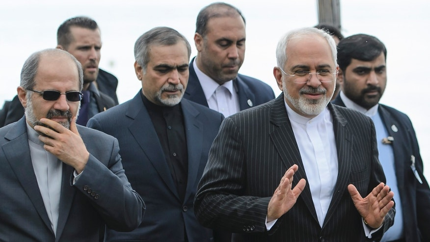 March 27, 2015 - Iranian Foreign Minister Mohammad Javad Zarif, right, walks outside the hotel during a  break after a bilateral meeting with U.S. Secretary of State John Kerry  for a new round of nuclear talks, in Lausanne, Switzerland.