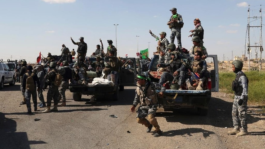 Iraqi security forces prepare to attack Islamic State extremist positions in Tikrit, 130 kilometers (80 miles) north of Baghdad, Iraq, Thursday, March 26, 2015. Iraqi troops started the final phase of an offensive to recapture Saddam Hussein's hometown of Tikrit on Thursday, a military official said, just hours after the United States launched airstrikes on the Islamic State held city. (AP Photo/Khalid Mohammed)