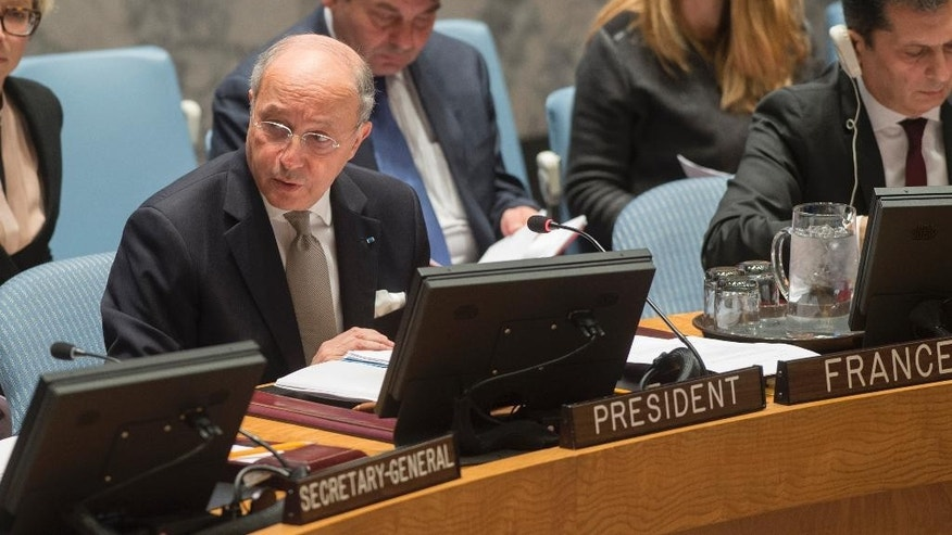 This photo provided by the United Nations  shows French Foreign Minister Laurent Fabius as he addresses United Nations Security Council, Friday, March 27, 2015.  Fabius said the council should refer the situation in Iraq and Syria to the International Criminal Court. (AP Photo/United Nations, Eskinder Debebe)