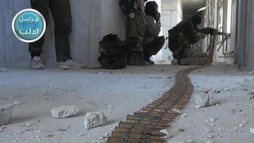 In this image posted on the Twitter page of Syria's al-Qaida-linked Nusra Front on Friday, March 27, 2015, which is consistent with AP reporting, fighters from Syria's al-Qaida-linked Nusra Front take their positions as they fight against the Syrian government forces in Idlib province, north Syria. Al-Qaida's affiliate in Syria, the Nusra Front, captured most of the northwestern city of Idlib from government forces Saturday, sweeping into neighborhoods in the center of the city in a powerful blow to President Bashar Assad's government, opposition activists and the group said. (AP Photo/Nusra Front on Twitter)