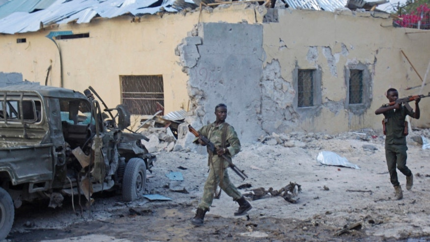 March 27, 2015: Somali soldiers take position after a bomb that was detonated at the gate of one of Mogadishu's most popular hotel.