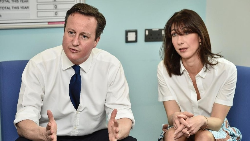"Britain's Prime Minister David Cameron and his wife Samantha Cameron during a visit to the Salford Royal Hospital in Manchester, England, before speaking at the Conservative Spring Forum, Saturday March 28, 2015. Cameron told a party conference Saturday that ""this isn't any election. This is a high-stakes, high-risk election."" He continued, ""this is a knife-edge election and can only be cut two ways: Conservative or Labour."" The campaign officially kicks off Monday, when Parliament is dissolved ahead of the May 7 vote. (AP Photo/PA, Ben Birchall)  UNITED KINGDOM OUT  NO SALES  NO ARCHIVE"
