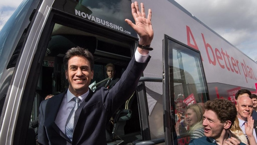 Labour Party leader Ed Miliband boards his General Election battle bus for the first time, as the Labour Party officially launch their 2015 General Election campaign at the Olympic Park in London Friday March 27, 2015. Britain will hold a General Election on Thursday May 7, 2015. (AP Photo/ Stefan Rousseau/PA) UNITED KINGDOM OUT