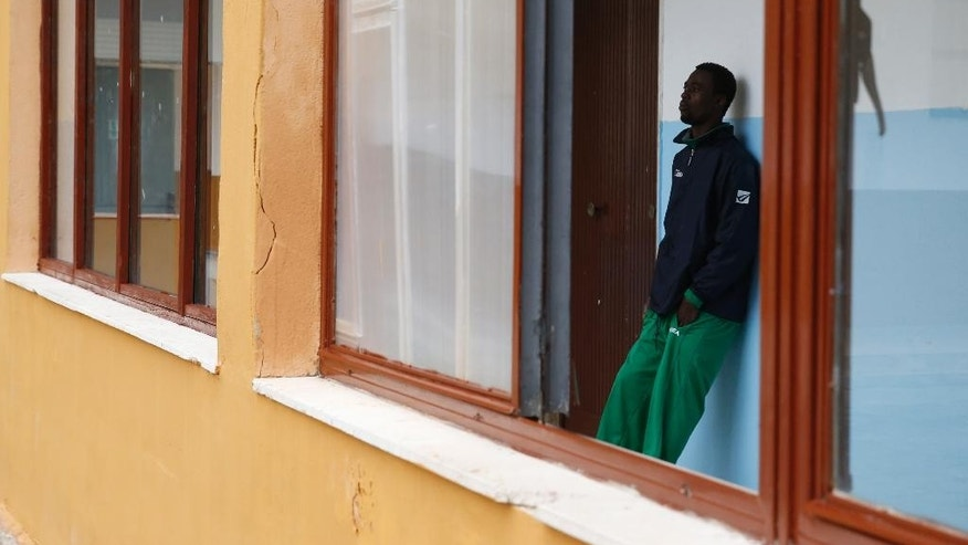 "In this picture taken Tuesday, March 24, 2015 and made available Saturday, March 28, 2015 Ismail Konate', a 23-year-old from Ivory Coast who traveled to Italy aboard a life raft, leans on a wall at the ""Umberto I"" migrant holding center in Siracusa, Sicily, Italy. The U.N. refugee agency reported that the number of asylum requests rose 148 percent in 2014 over the previous year, far surpassing its previous all-time high in 2011 some 40,000 people sought refugee status in Italy during the Arab Spring. (AP Photo/Luca Bruno)"