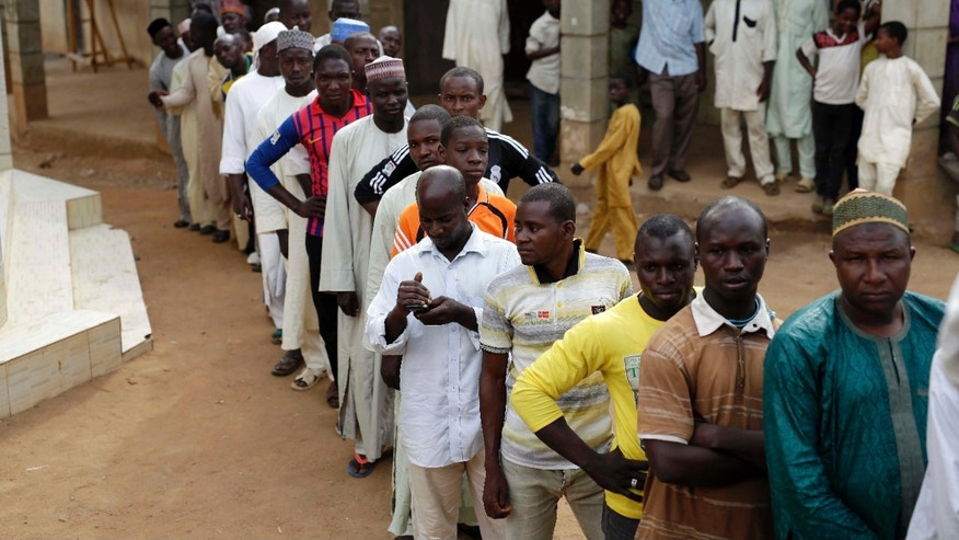 March 28, 2015: Nigerians wait to register before voting in Jere, some 60 kilometers (40 miles) from the capital Abuja, Nigeria