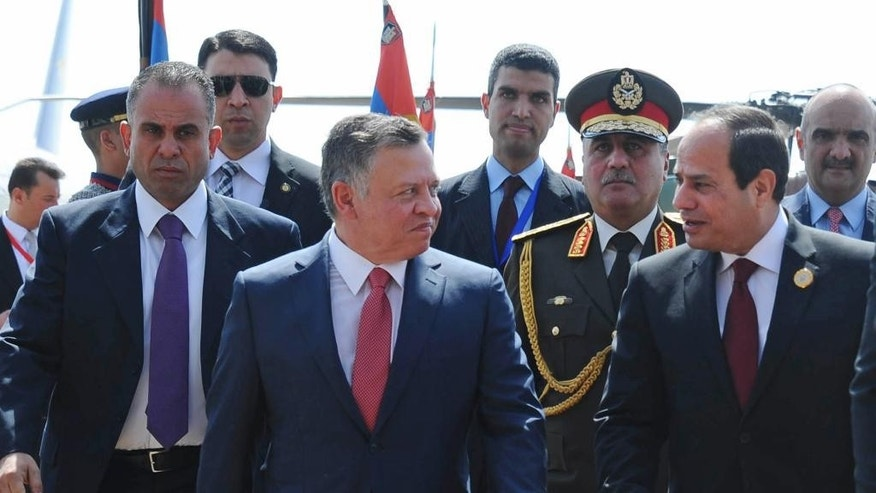 "Egyptian President Abdel Fattah al-Sisi, right, greets Jordan's King Abdullah II on his arrival to attend an Arab summit, in Sharm el-Sheikh, South Sinai, Egypt, Saturday, March 28, 2015. In a speech to Arab leaders, Yemen's embattled president on Saturday called Shiite rebels who forced him to flee the country ""puppets of Iran,"" directly blaming the Islamic Republic for the chaos there and demanding airstrikes against rebel positions continue until they surrender. (AP Photo/MENA)"
