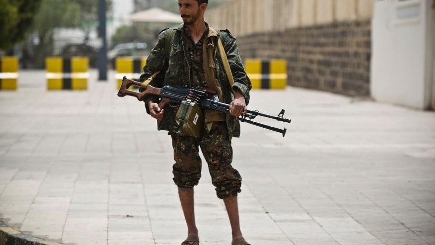 "A Shiite rebel, known as Houthi, wearing an army uniform, stands guard in front of the international airport in Sanaa, Yemen, Saturday, March 28, 2015. Yemen's President Abed Raboo Mansour Hadi, speaking at the opening session of an Arab summit in Egypt on Saturday, called Shiite rebels who forced him to flee the country ""stooges of Iran,"" directly blaming the Islamic Republic for the chaos there and demanding airstrikes against rebel positions continue until they surrender. (AP Photo/Hani Mohammed)"