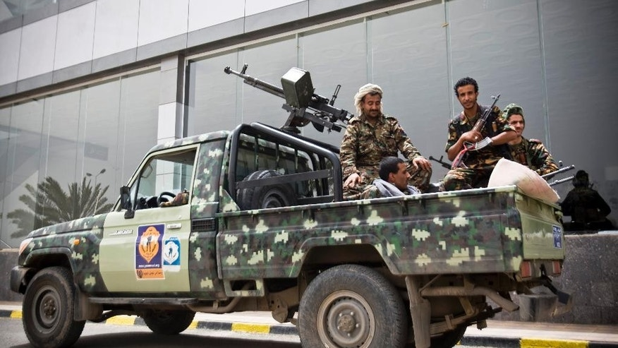 "Shiite rebels, known as Houthis, wearing an army uniform, ride on an armed truck to patrol the Sanaa International Airport in Sanaa, Yemen, Saturday, March 28, 2015. Yemen's President Abed Raboo Mansour Hadi, speaking at the opening session of an Arab summit in Egypt on Saturday, called Shiite rebels who forced him to flee the country ""stooges of Iran,"" directly blaming the Islamic Republic for the chaos there and demanding airstrikes against rebel positions continue until they surrender. (AP Photo/Hani Mohammed)"