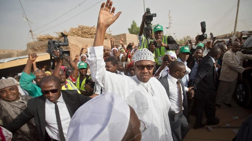 Opposition candidate Gen. Muhammadu Buhari waves to supporters after casting his vote in his home town of Daura, northern Nigeria Saturday, March 28, 2015. Nigerians went to the polls Saturday in presidential elections which analysts say will be the most tightly contested in the history of Africa's richest nation and its largest democracy. (AP Photo/Ben Curtis)