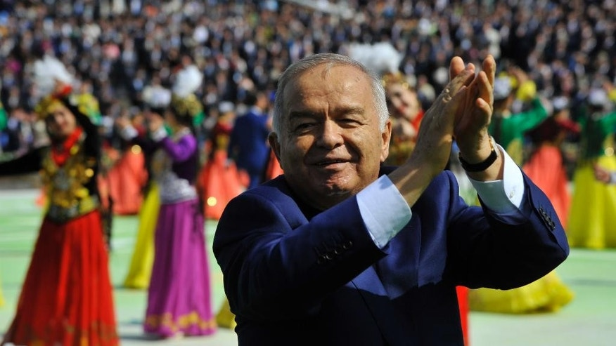 "FILE - In this Saturday March 21, 2015 file photo, Uzbekistan's President Islam Karimov greets people during the festivities marking the Navruz holiday, or a sping ""New Year"" holiday, in Tashkent, Uzbekistan. Uzbekistan is going through the motions of a presidential election this weekend, with a crushing win for its longtime leader a foregone conclusion, but the long-term future of the Central Asian nation is still far from certain. Islam Karimov, 77, has led the double-landlocked former Soviet republic of 30 million people uninterruptedly since the late 1980s. (AP Photo/File)"