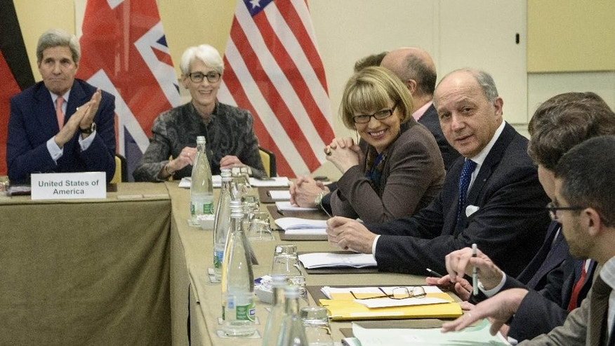 US Secretary of State, John Kerry, left, US Under Secretary for Political Affairs, Wendy Sherman, 2nd left, French Foreign Minister, Laurent Fabius, right, and others wait for the start of a trilateral meeting at an hotel in Lausanne Saturday, March 28, 2015. Negotiations over Iran's nuclear program picked up pace on Saturday with the French and German foreign ministers joining U.S. Secretary of State John Kerry in talks with Tehran's top diplomat ahead of an end-of-March deadline for a preliminary deal. (AP Photo/Brendan Smialowski, Pool)