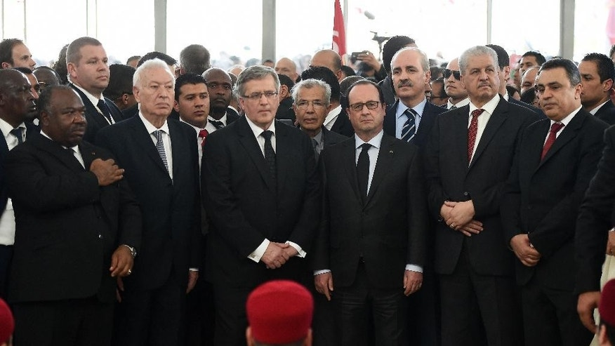 From left, Gabon's President Ali Bongo Ondimba , Spanish Foreign Minister Jose Manuel Garcia-Margallo, Polish President Bronislaw Komorowski, French President Francois Hollande, Algerian Prime Minister Abdelmalek Sellal, and former Tunisian prime minister Mehdi Jomaa listen to  a musical homage  in Tunis, Sunday, March 29, 2015. Tens of thousands of Tunisians attended a march in their country's capital, Tunis, on Sunday to denounce extremist violence following the attack on the National Bardo Museum. (AP Photo /Emmanuel Dunand, Pool)
